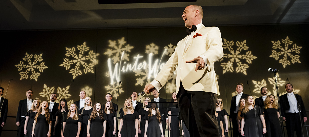 Corin Overland conducts a choir at Winter Wonderful